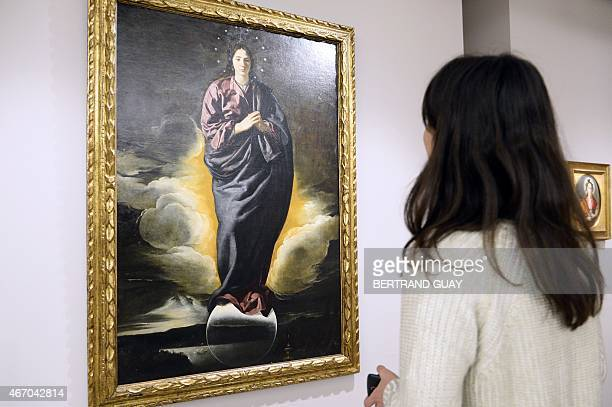 A person looks at the Diego Velasquez painting 'Immaculada' on March 20 during the press day of the exhibition 'Velazquez' at the Grand Palais in...