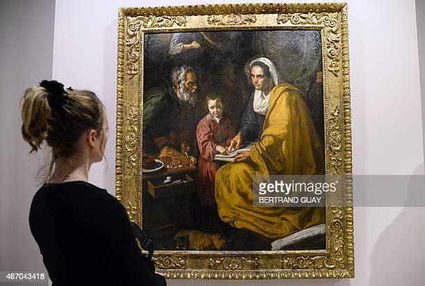 A person looks at the Diego Velasquez painting 'La educacion de la Virgen' on March 20 during the press day of the exhibition 'Velazquez' at the...