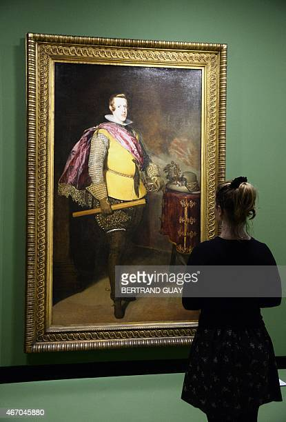A person looks at the Diego Velasquez painting 'Retrato de Felipe IV ' on March 20 during the press day of the exhibition 'Velazquez' at the Grand...