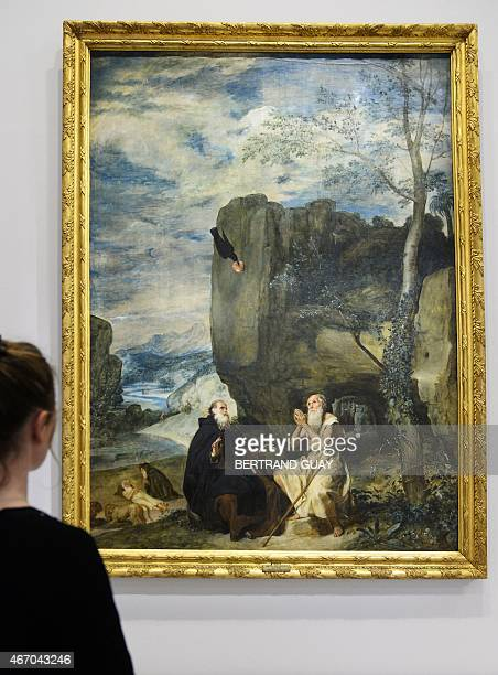 A person looks at the Diego Velasquez painting 'San Antonio Abad y san Pablo ermitano' on March 20 during the press day of the exhibition 'Velazquez'...