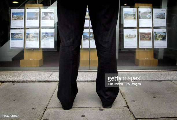 A person looks into an estate agent's window in London after the Chancellor announced that homes worth 175000 or less are to be exempted from stamp...