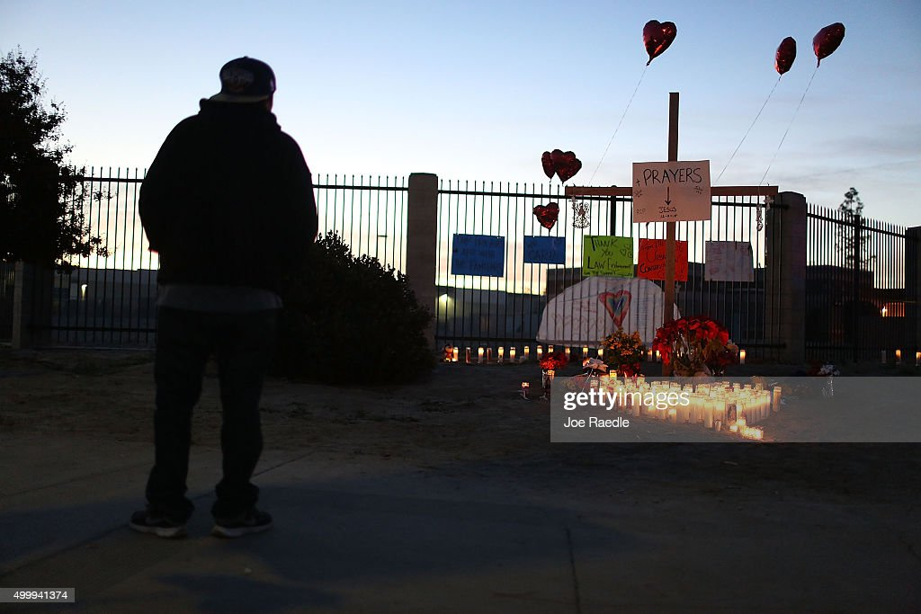 A person looks on at a memorial near the Inland Regional Center as the community remembers those injured and killed during the shooting at the center on December 4, 2015 in San Bernardino, California. Police continue to investigate a mass shooting at the Inland Regional Center in San Bernardino that left at least 14 people dead and another 17 injured on December 2nd.