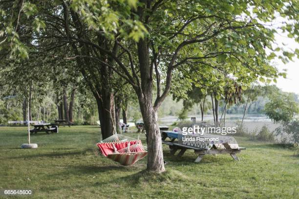A person lying in a hammock