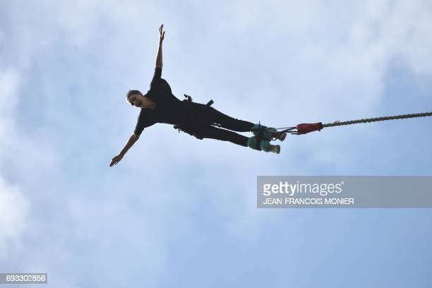 A person makes a bungee jump from the Souleuvre Viaduct where Alan John Hackett of New Zealand created his first spot on June 6 2017 in La...