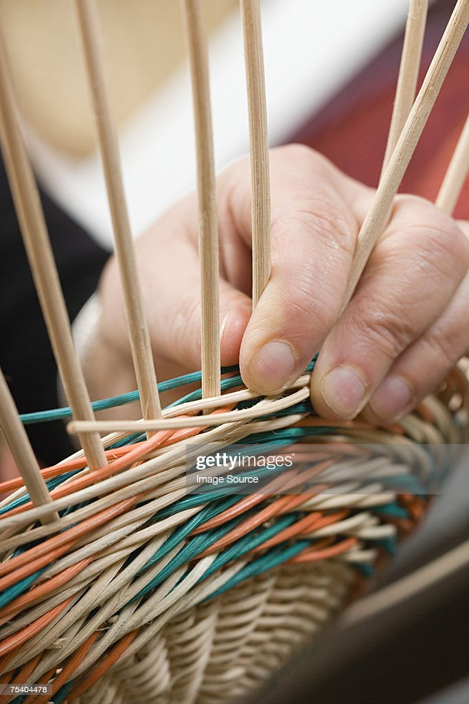 Person making basket