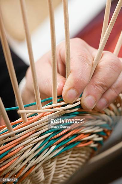 Person making basket