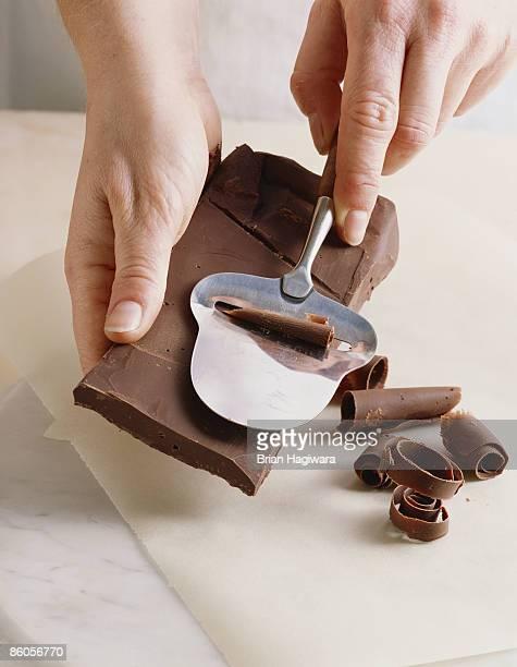 Person making chocolate shavings