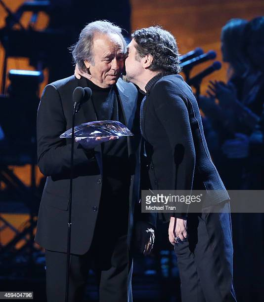 Person of the Year honoree Joan Manuel Serrat and recording artist Joaquin Sabina speak onstage during the 15th Annual Latin GRAMMY Awards held at...