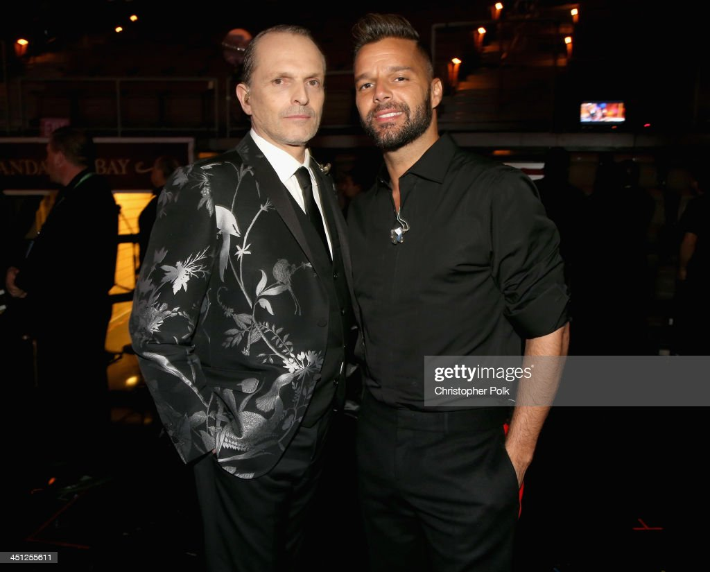 Person of the Year honoree <a gi-track='captionPersonalityLinkClicked' href=/galleries/search?phrase=Miguel+Bose&family=editorial&specificpeople=577901 ng-click='$event.stopPropagation()'>Miguel Bose</a> (L) and musician <a gi-track='captionPersonalityLinkClicked' href=/galleries/search?phrase=Ricky+Martin&family=editorial&specificpeople=160450 ng-click='$event.stopPropagation()'>Ricky Martin</a> pose backstage during the 14th Annual Latin GRAMMY Awards held at the Mandalay Bay Events Center on November 21, 2013 in Las Vegas, Nevada.