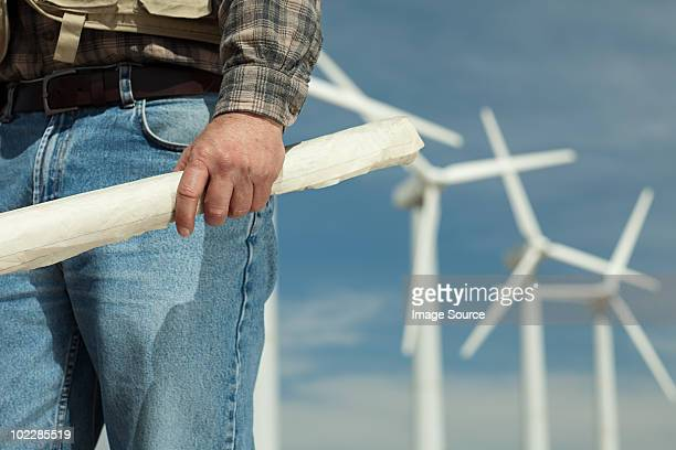 Person on a wind farm with plans