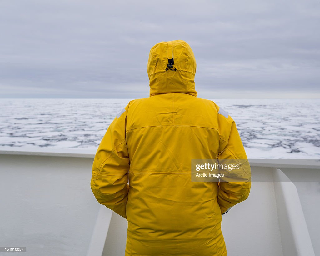 Person on deck looking at the packed ice : Stock Photo