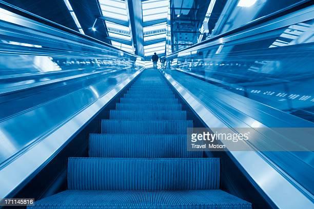 Person on escalator in modern railway station, Amsterdam Bijlmer Arena