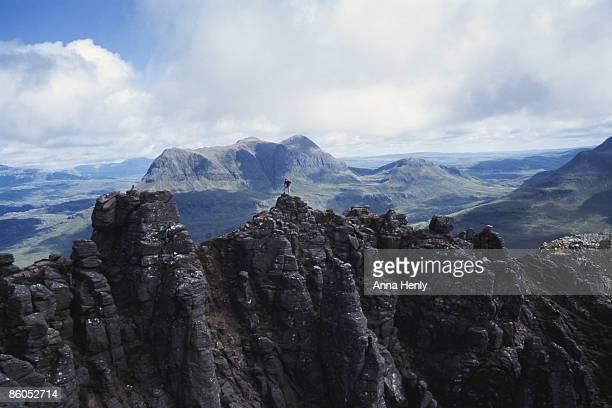 Person on jagged mountain peak, Scotland