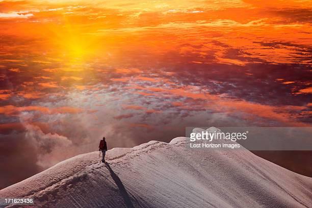 Person on mountain at sunset, Piz Palu, St Moritz, Canton Graubunden, Switzerland