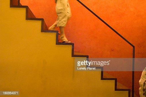 Person on stairs inside Indigo, Colaba. : Stock Photo