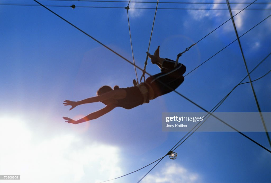 Person on trapeze