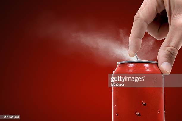 Person opening can of carbonated beverage