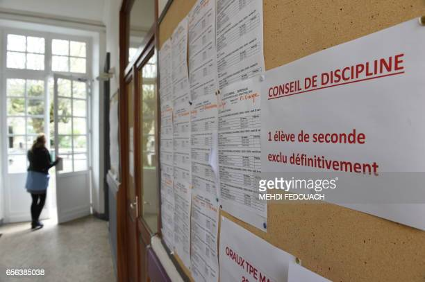 A person opens the door next to an information board in Le Mirail High School in Bordeaux southwestern France on March 20 2017 This nonstandard high...