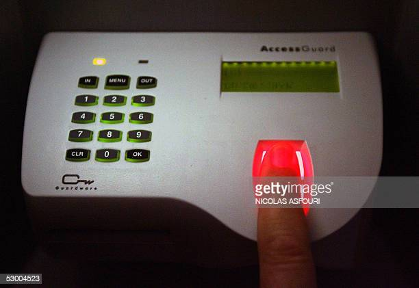 A person opens the socalled 'House of the Future' with a finger print scan during an exhibition at the museum of communication in Lisbon 24 May 2005...