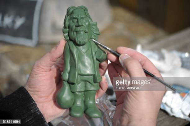 A person paint a garden gnome picturing 'The Dude' a character from the Cohen brothers' movie 'The Big Lebowski' during the 'Nainportequoi' festival...