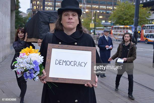 A person participates in a demonstration in solidarity with the people of Wallonia against 'CETA' on October 27 2016 in Manchester England CETA is...