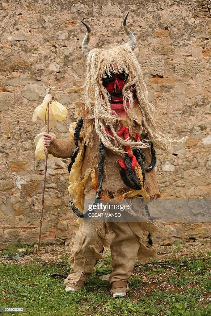 A person performing 'Zarramaco' character poses during the celebration of 'El Gallo de Carnaval' (The Carnival's Cock) in Mecerreyes, in the northern Spanish province of Burgos, on February 7, 2016. The Gallo Carnival is a pagan festival in which people participate singing, dancing and attacking the 'Gallo' that is defended by Zarramacos. AFP PHOTO / CESAR MANSO / AFP / CESAR MANSO