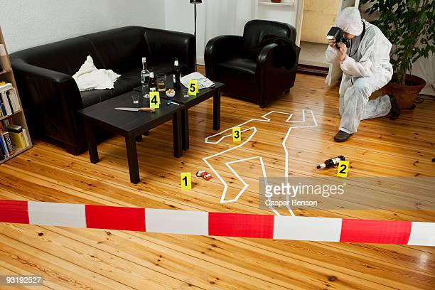 A person photographing a crime scene