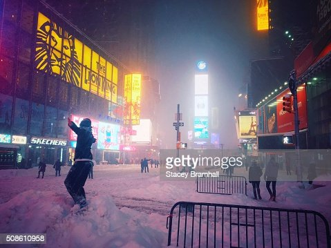 A person playing in the snow in Times Square during the 2016 blizzard : Stock Photo