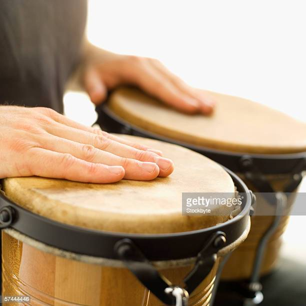 Person playing the bongo