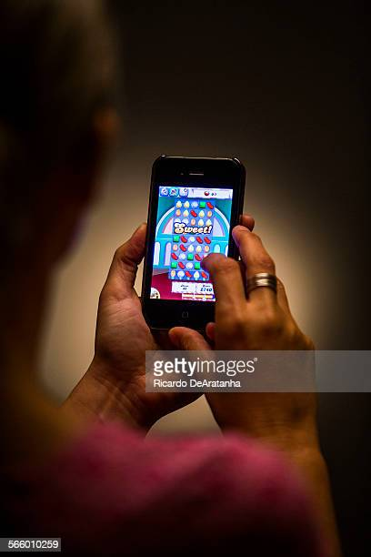 A person playing the Candy Crush Saga game as beeing photographed in the Los Angeles Times studio May 16 2013