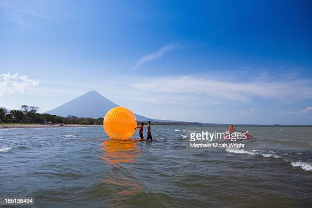 A person plays in a giant ball pulled by waterski