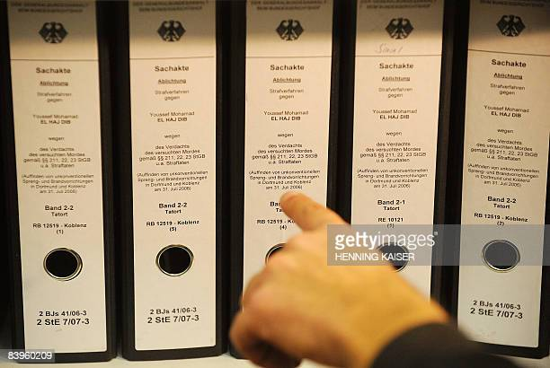 A person points to the folders diplayed at court and related to the case of Lebanese convicted Yusef Mohammed alHajj Dib in the western town of...