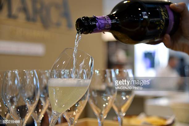 A person poors a glass of Prosecco on April 10 2016 during the 50th edition of the Vinitaly wine exhibition in Verona Vinitaly is the worlds largest...