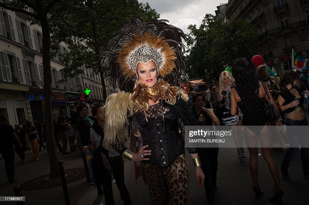 A person poses as she parades during the homosexual, lesbian, bisexual and transgender (HLBT) visibility march, the Gay Pride, on June 29, 2013 in Paris, exactly one month to the day since France celebrated its first gay marriage. AFP PHOTO / MARTIN BUREAU
