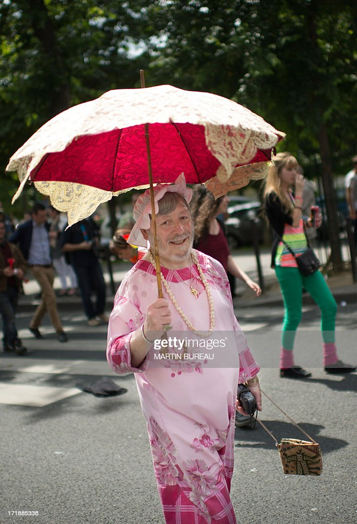 A person poses as she parades during the homosexual, lesbian, bisexual and transgender (HLBT) visibility march, the Gay Pride, on June 29, 2013 in Paris, exactly one month to the day since France celebrated its first gay marriage.