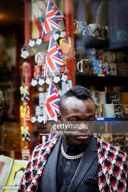 A person poses for a photograph outside the BFC Show Space on Brewer Street Soho during London Fashion Week Spring/Summer 2016 on September 22 2015...