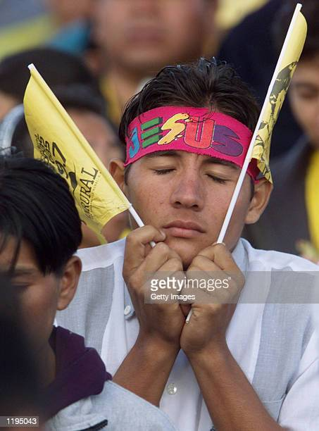 A person prays at the begining of Mass July 30 2002 in Guatemala City Guatemala The pope declared Pedro de San Jose Betancur a saint the first from...