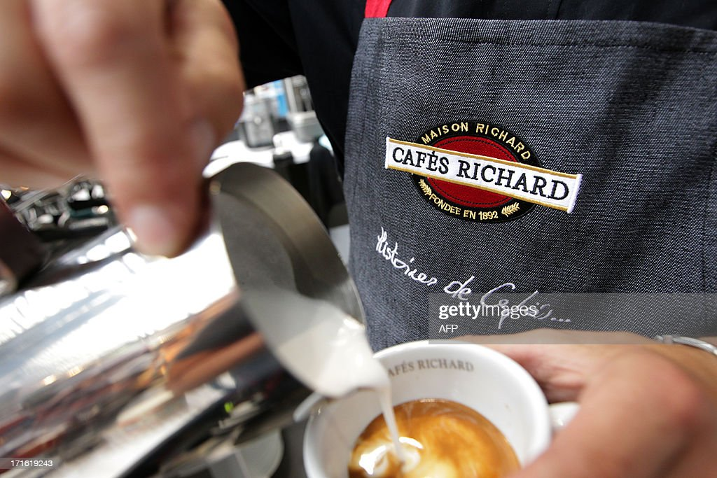 A person prepares a coffee during the exhibition 'World of coffee', on June 27, 2013, in Nice, southeastern France.
