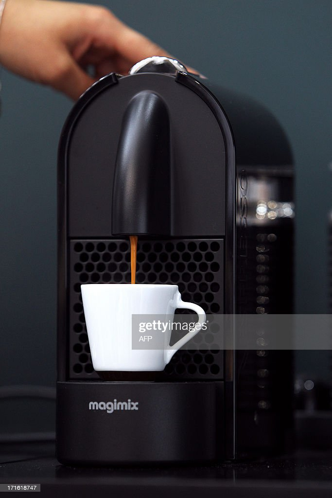 A person prepares a cup of coffee during the exhibition 'World of coffee', on June 27, 2013, in Nice, southeastern France.