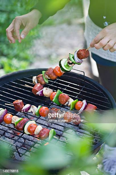 Person preparing barbecue