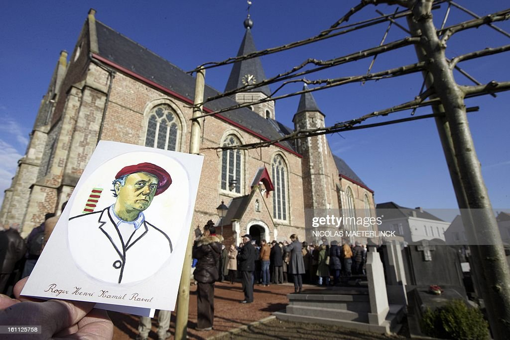 A person presents an obituary notice of Belgian painter Roger Raveel during his funeral ceremony, on February 9, 2013 in Machelen-aan-de-Leie. Roger Raveel died on January 30 at the age of 91. MAETERLINCK