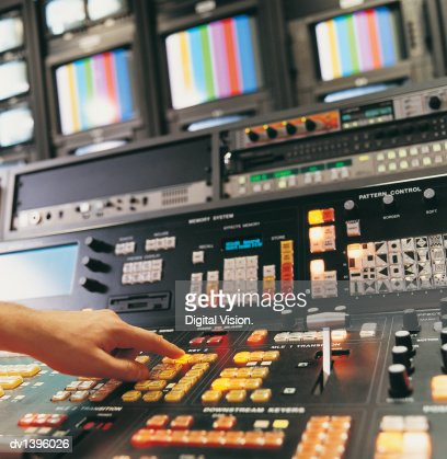 Person Pressing Buttons on a TV Studio Control Panel : Stock Photo