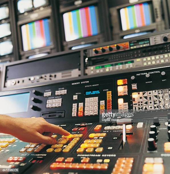 Person Pressing Buttons on a TV Studio Control Panel