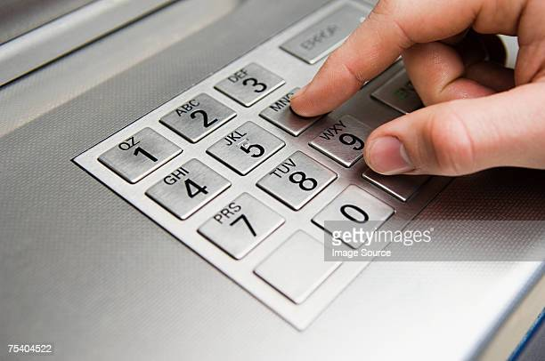 Person pressing cash machine keypad