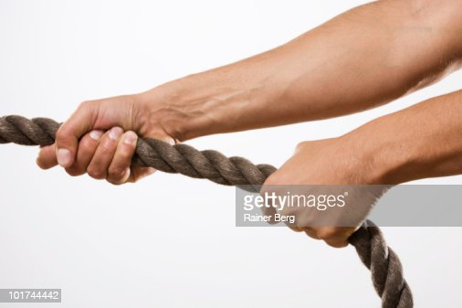Person pulling rope, close-up