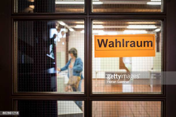 A person puts the ballot paper in the voting box on September 24 2017 in Diehsa Germany This Sunday 615 million people of Germany are called to give...