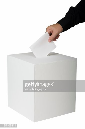 A person putting a vote in a ballot box