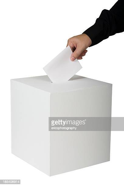 A person putting a vote in a ballot box