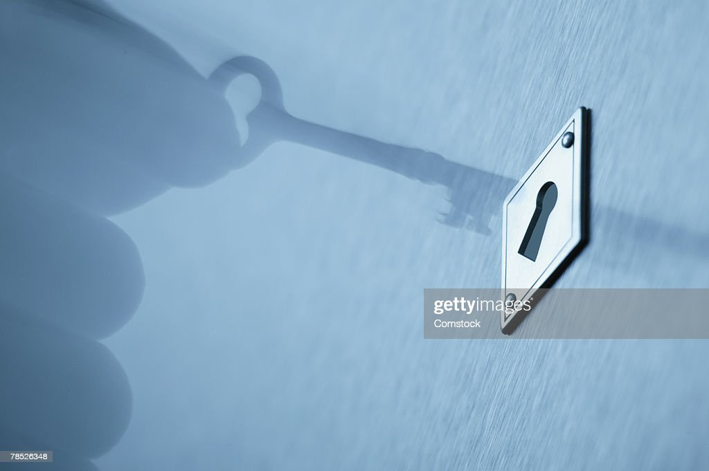 Person putting key into keyhole