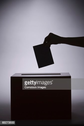 Person putting paper in box